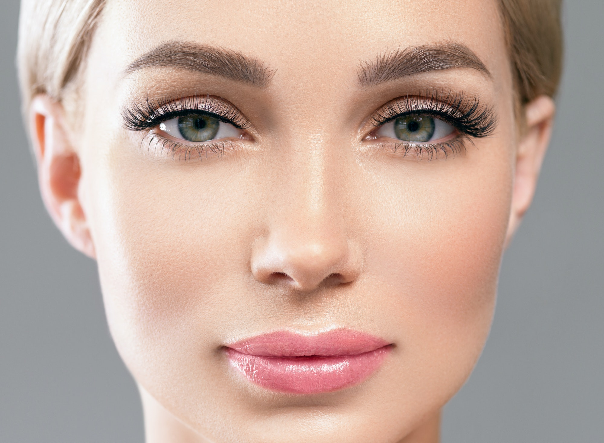 Lashes extension beauty pink lipstick blonde woman